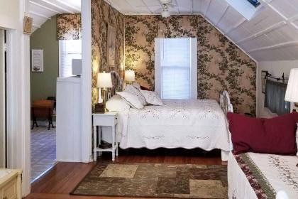 Wrought iron king bed, day bed, and kitchenette